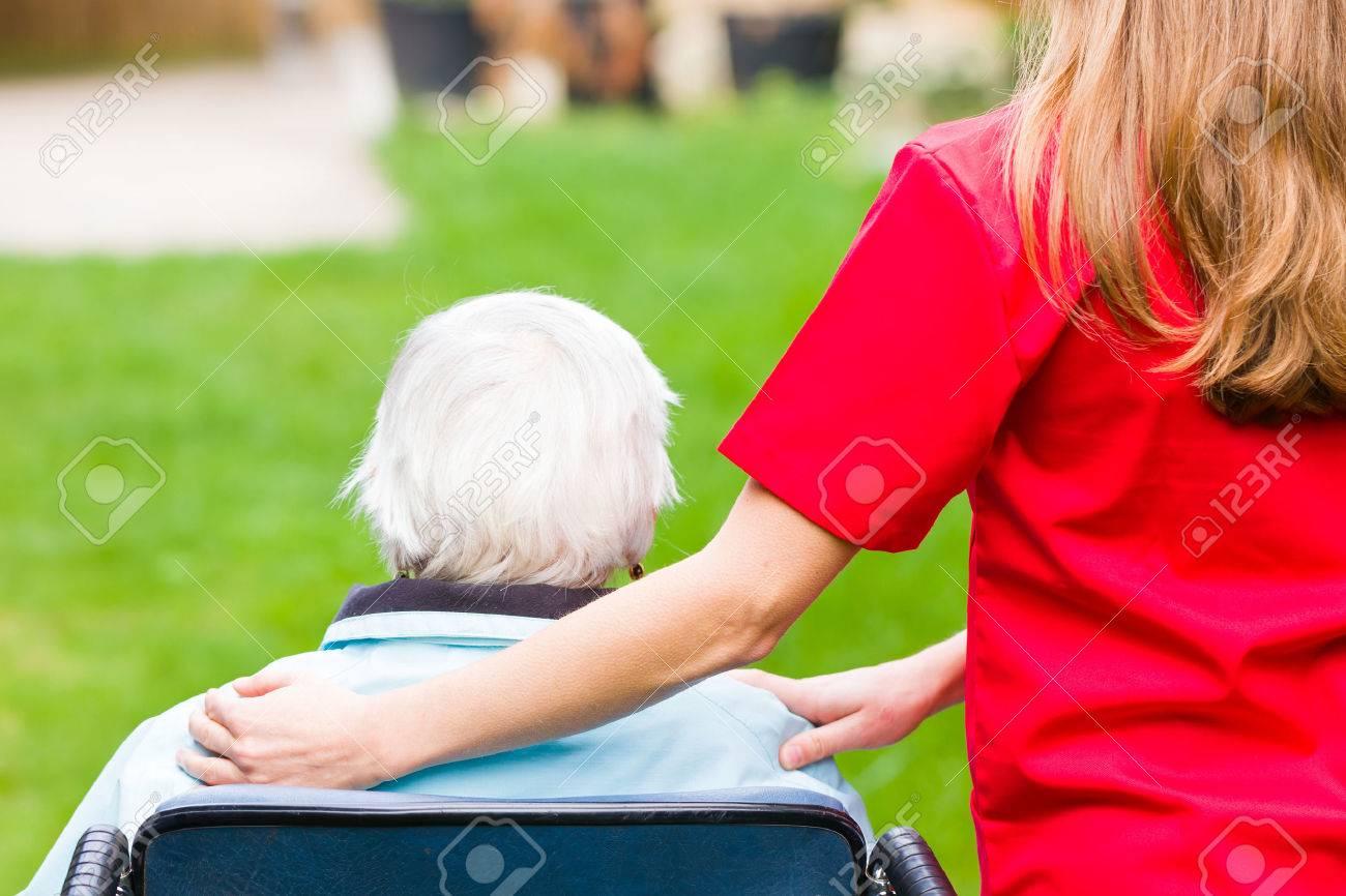 Photo of elderly woman with the caregiver Standard-Bild - 37013538