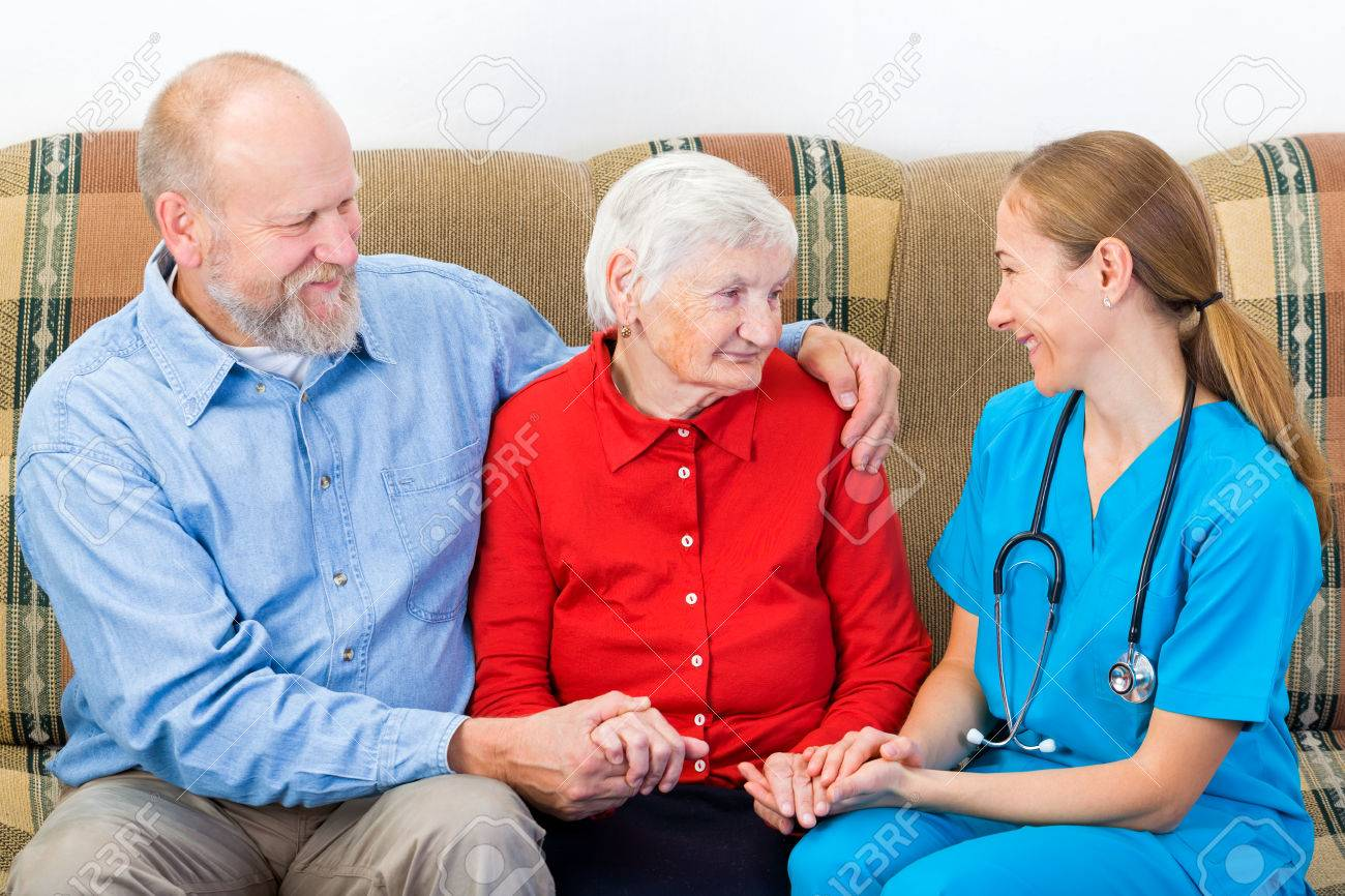 Elderly woman and her son at the doctor Standard-Bild - 37013591