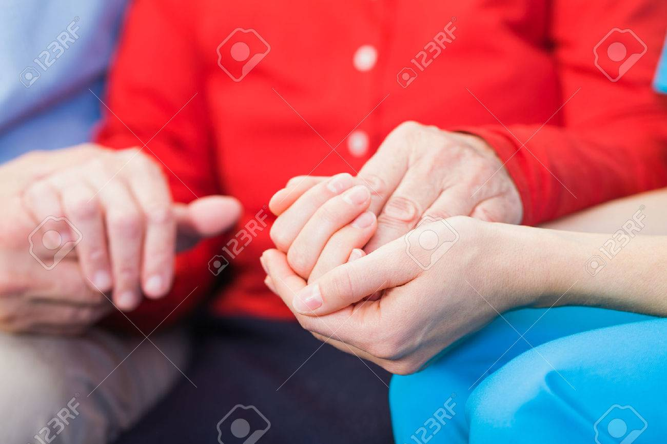 Young carer giving helping hands for elderly woman Standard-Bild - 37013595