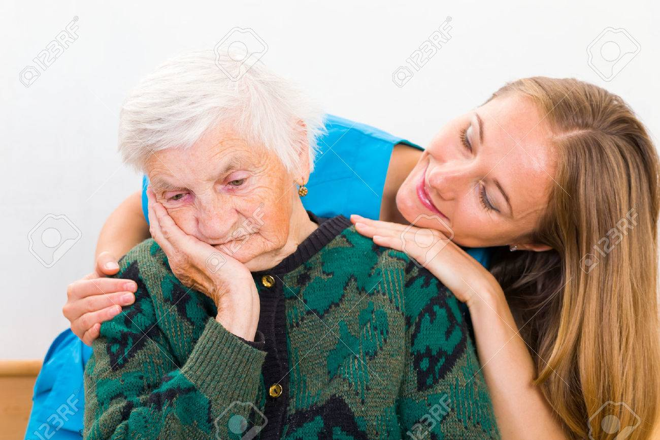 Photo of elderly woman supported by young doctor Standard-Bild - 37013688