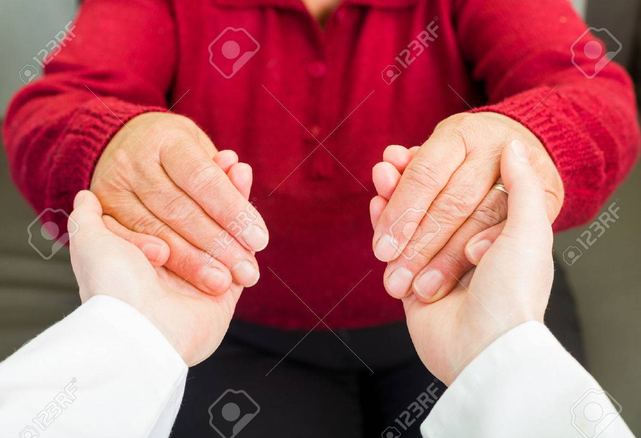 Young carer giving helping hands for elderly woman Standard-Bild - 37848939