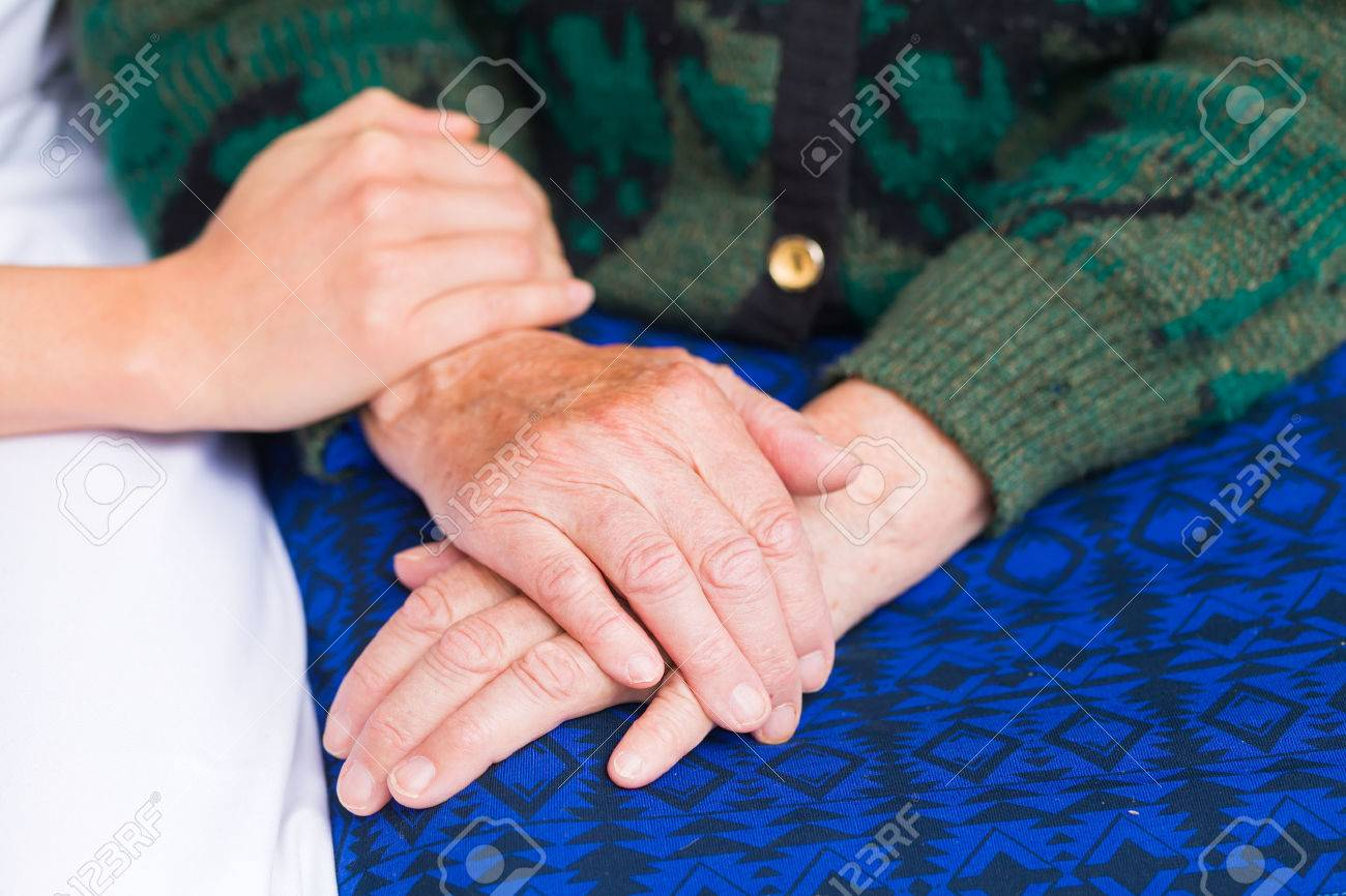 Young carer giving helping hands for elderly woman Standard-Bild - 37962229