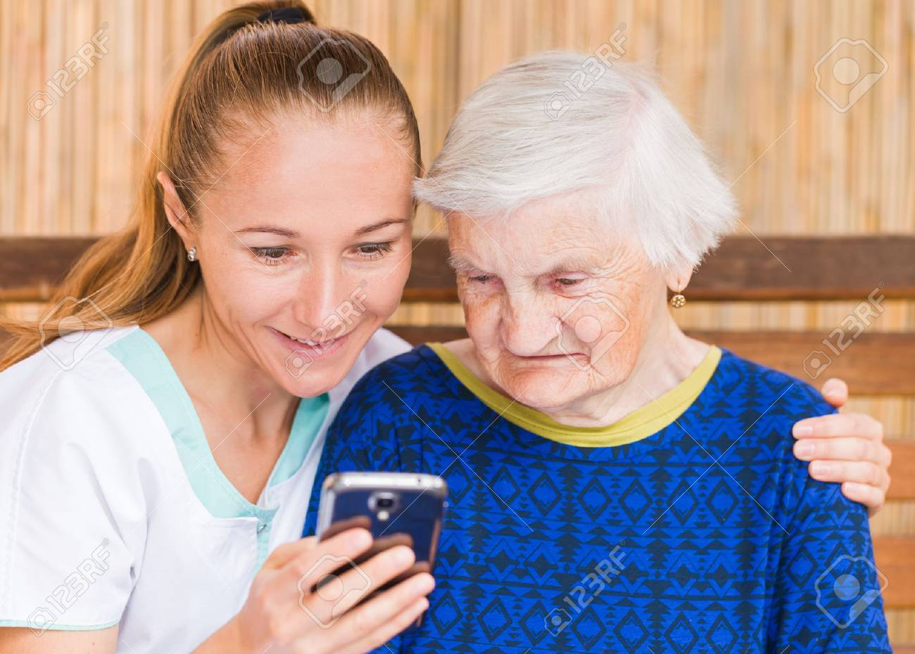 Photo of elderly woman with her caregiver Standard-Bild - 38190553