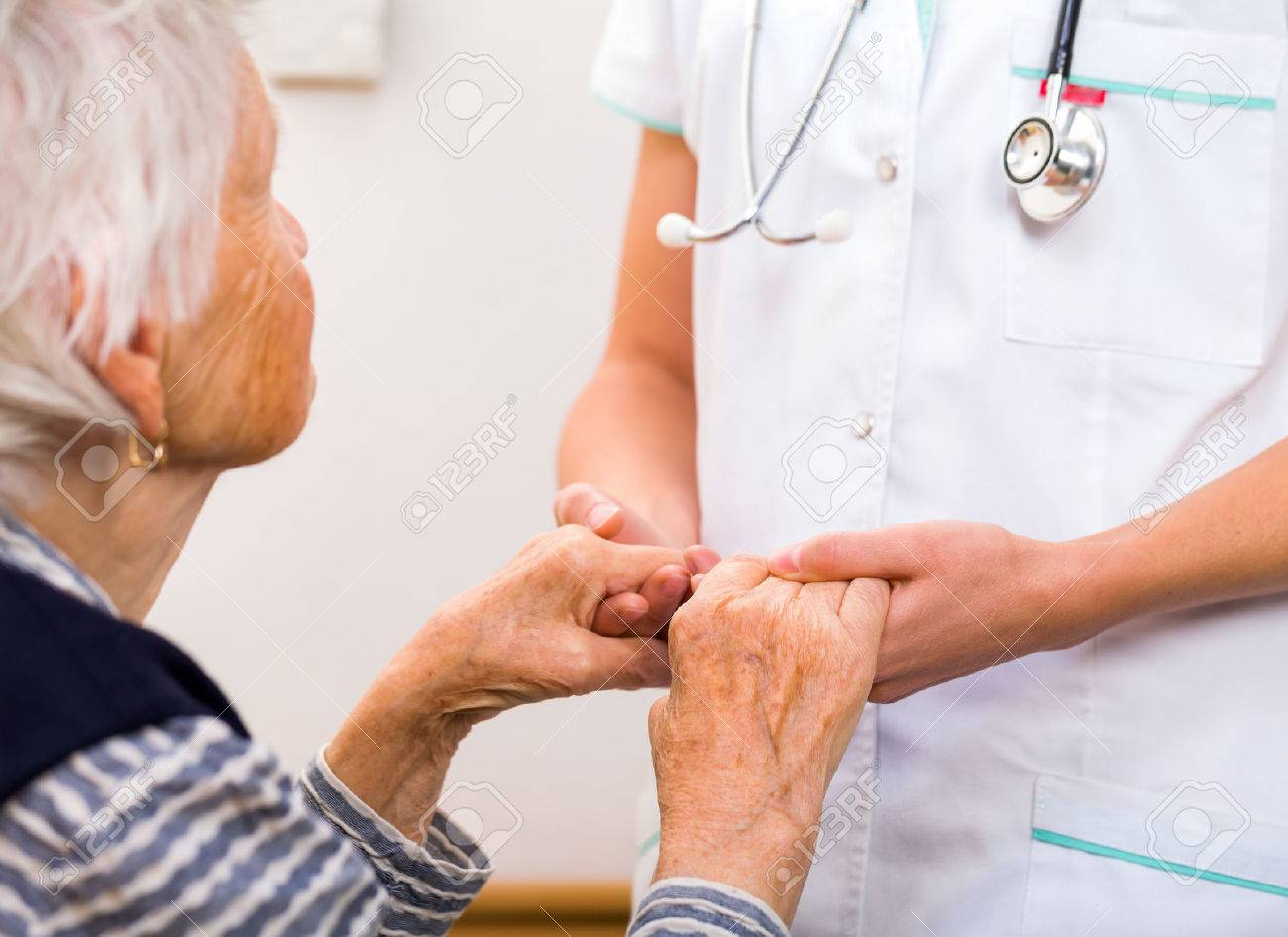 Young doctor giving helping hands for elderly woman Standard-Bild - 37849051