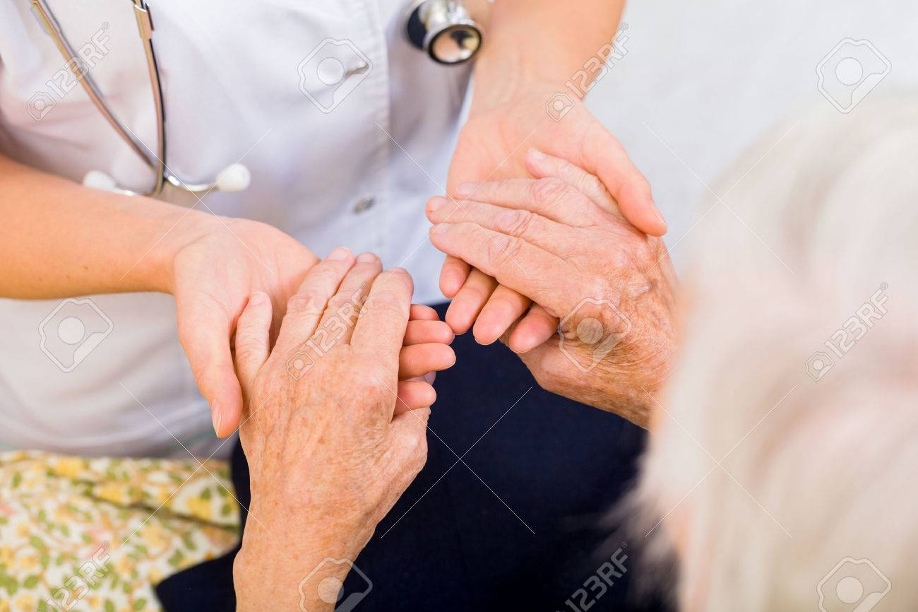 Young doctor giving helping hands for elderly woman Standard-Bild - 37849052