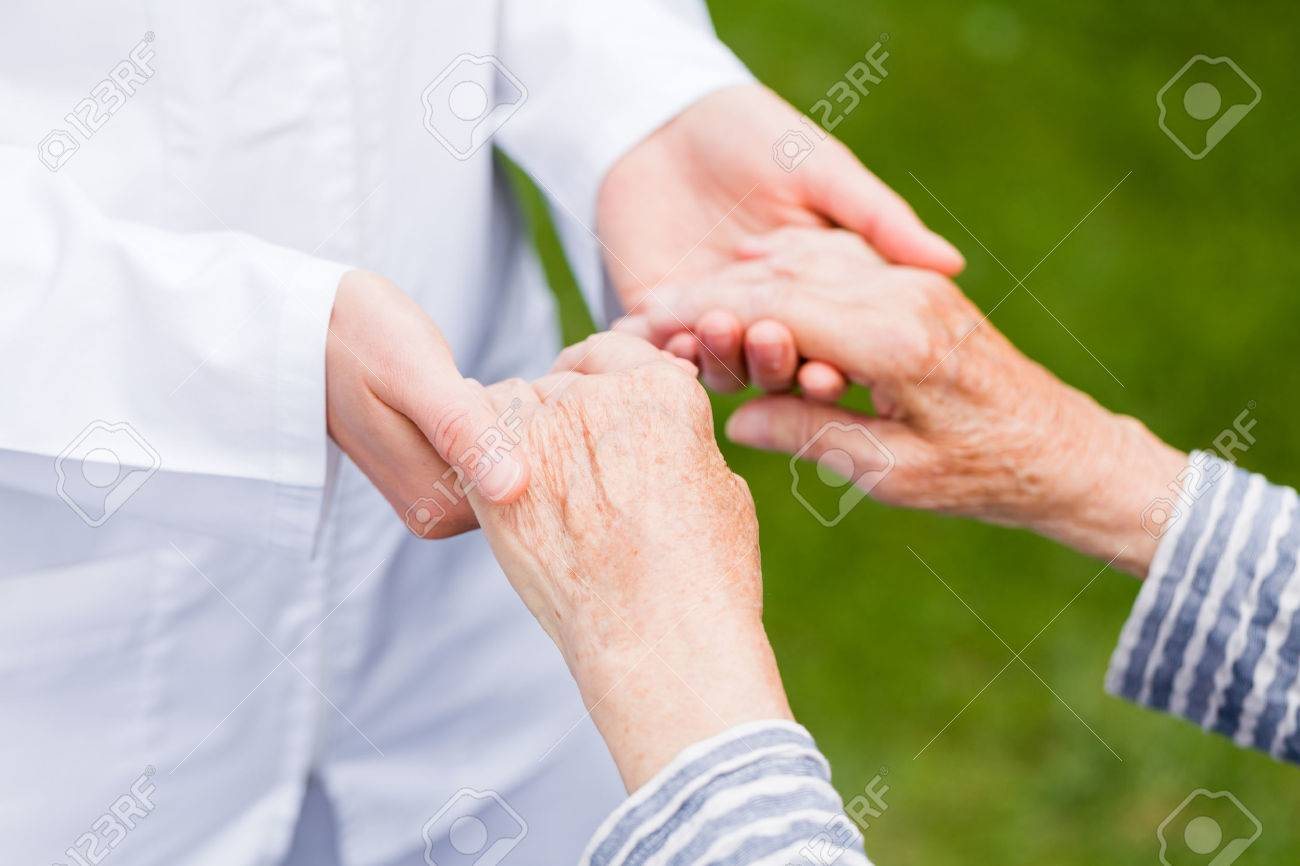 Young carer giving helping hands for elderly woman Standard-Bild - 37849279