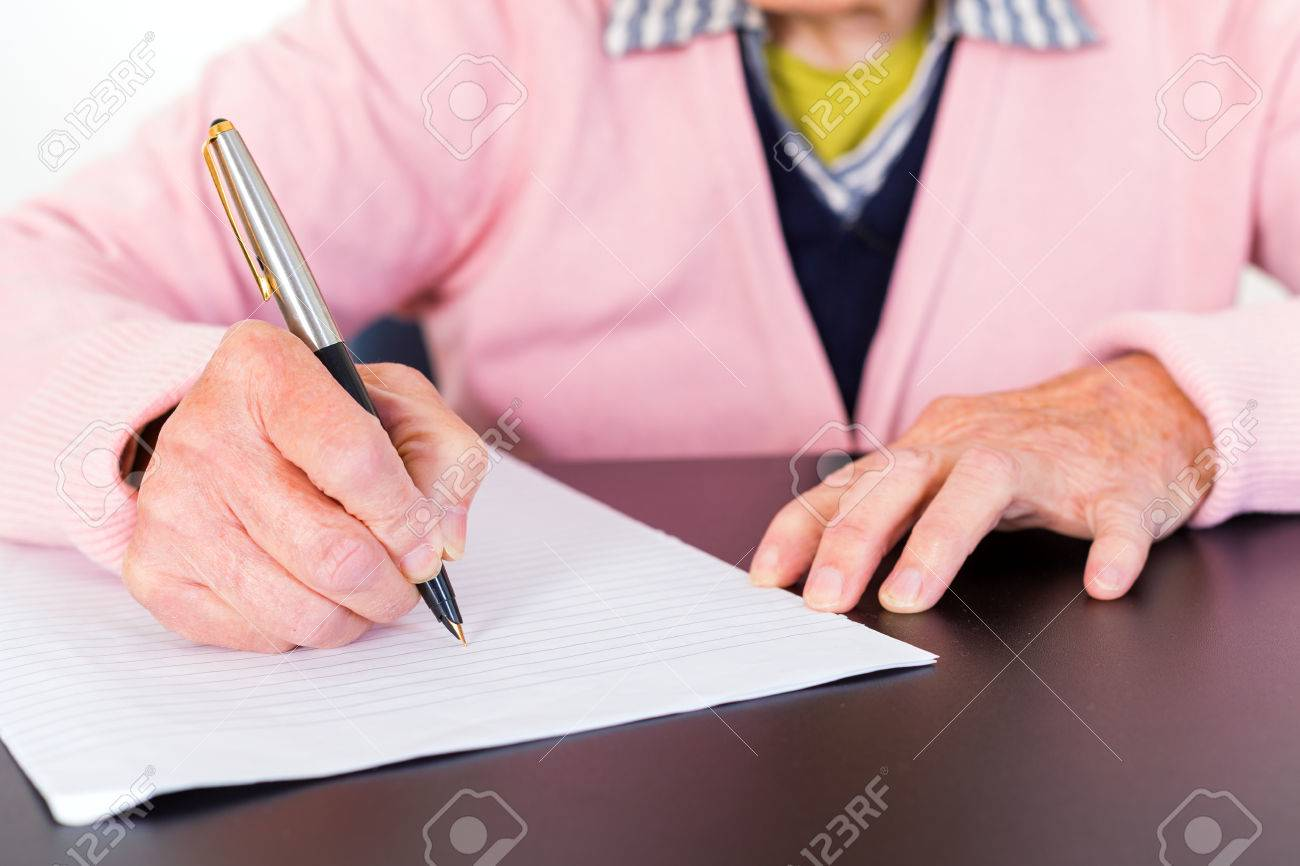 Photo of elderly woman who is writing a letter Standard-Bild - 37962299