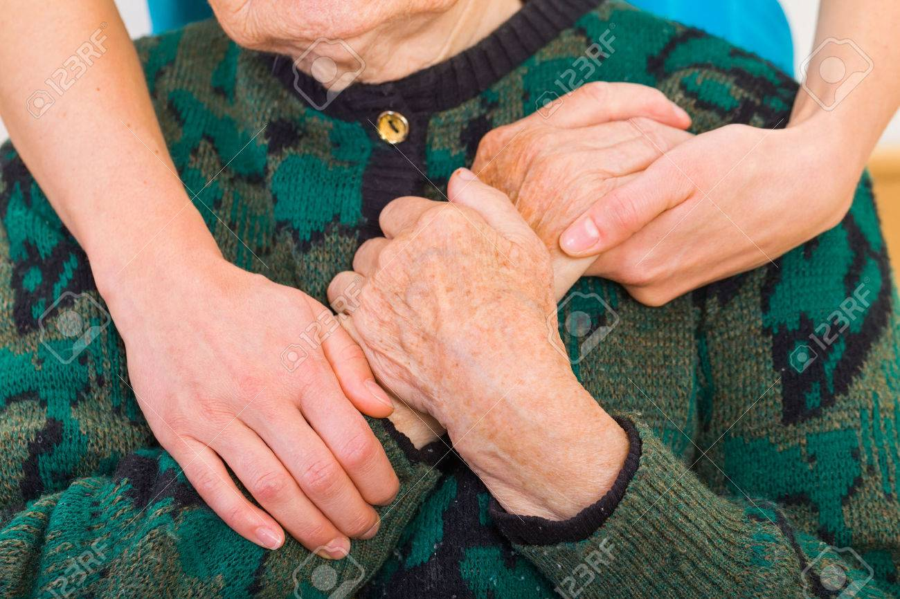 Young doctor giving helping hands for elderly woman Standard-Bild - 37857621