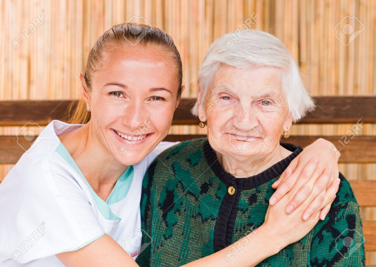 Photo of elderly woman with her caregiver Standard-Bild - 44600710