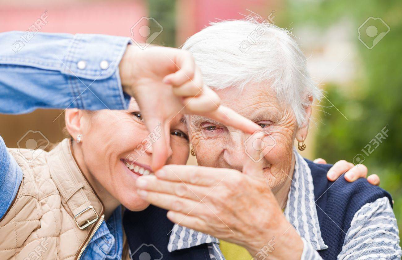 Photo of elderly woman with grandchild having funny Standard-Bild - 44600676