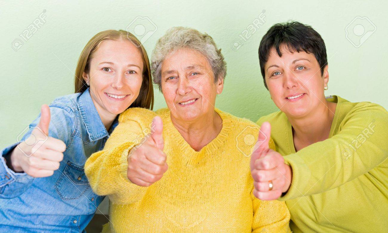 Photo of elderly woman with her daughters showing thumbs up Standard-Bild - 44600657