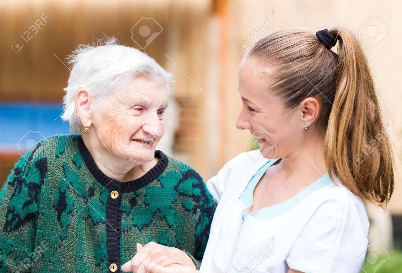 Photo of elderly woman with her caregiver Standard-Bild - 44600644