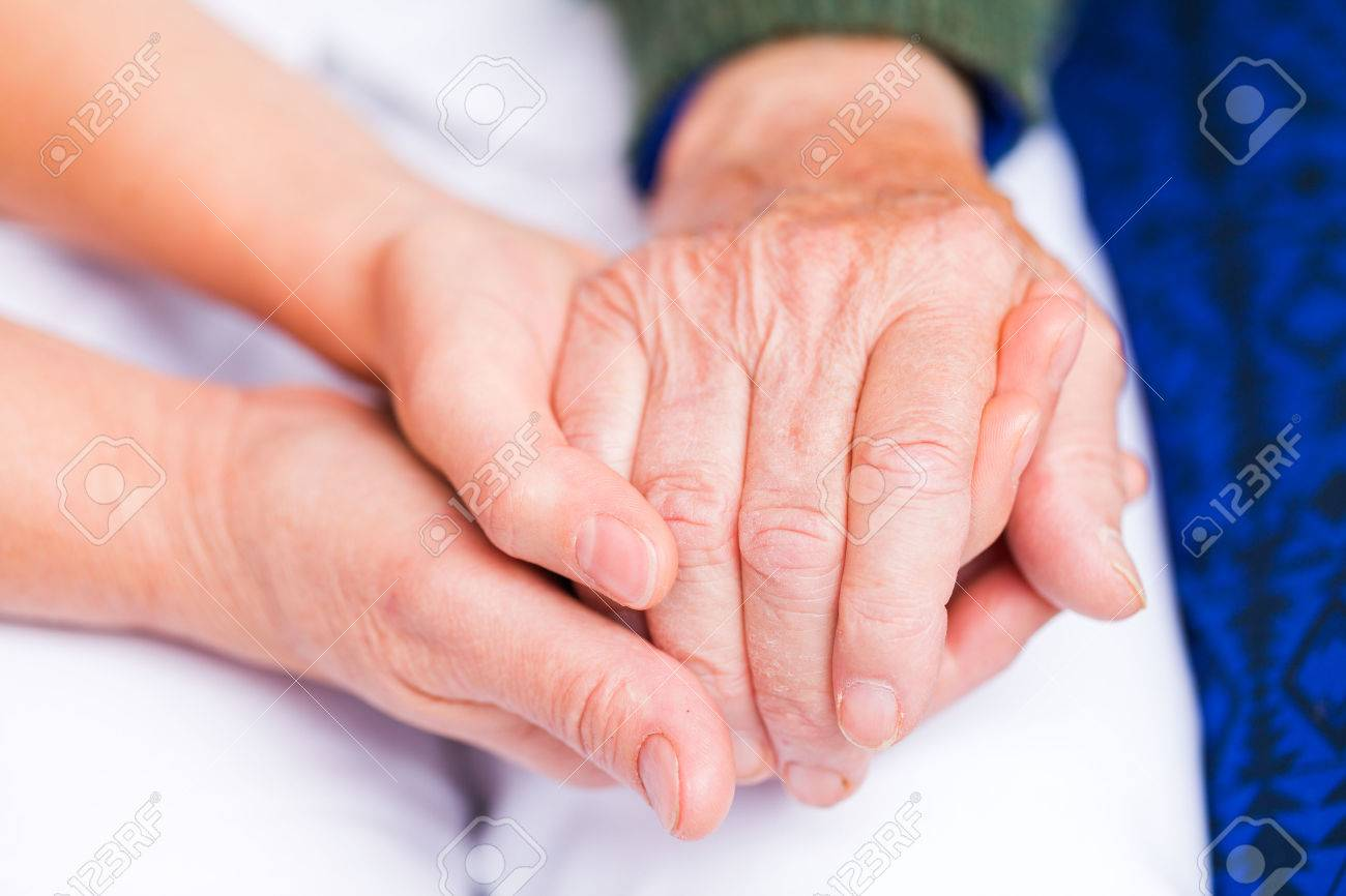 Young carer giving helping hands for elderly woman Standard-Bild - 51731685