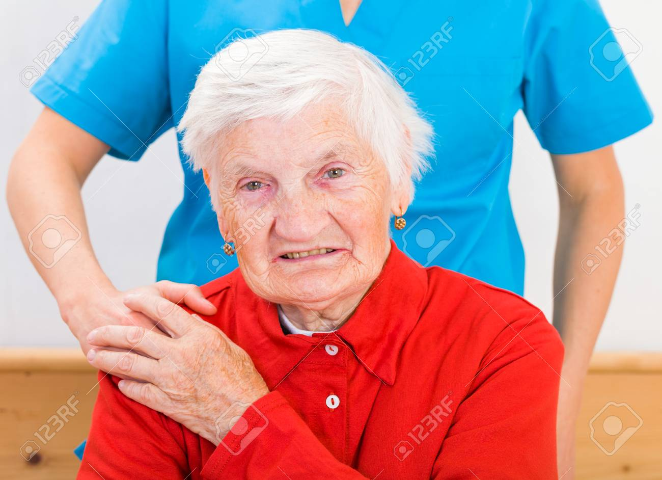 Photo of elderly woman supported by young doctor - 51731709