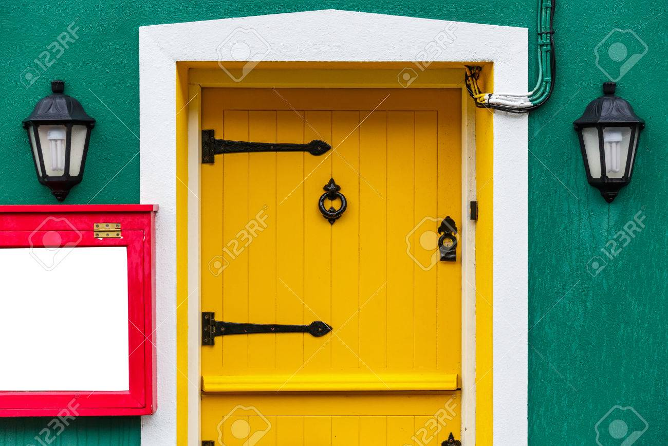 Photo Of A Yellow Front Door And Two Decor Lamps Stock Photo ...