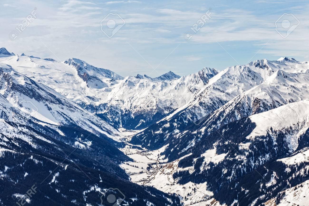 Landscape photo of snowy mountains in Alps Standard-Bild - 64157227