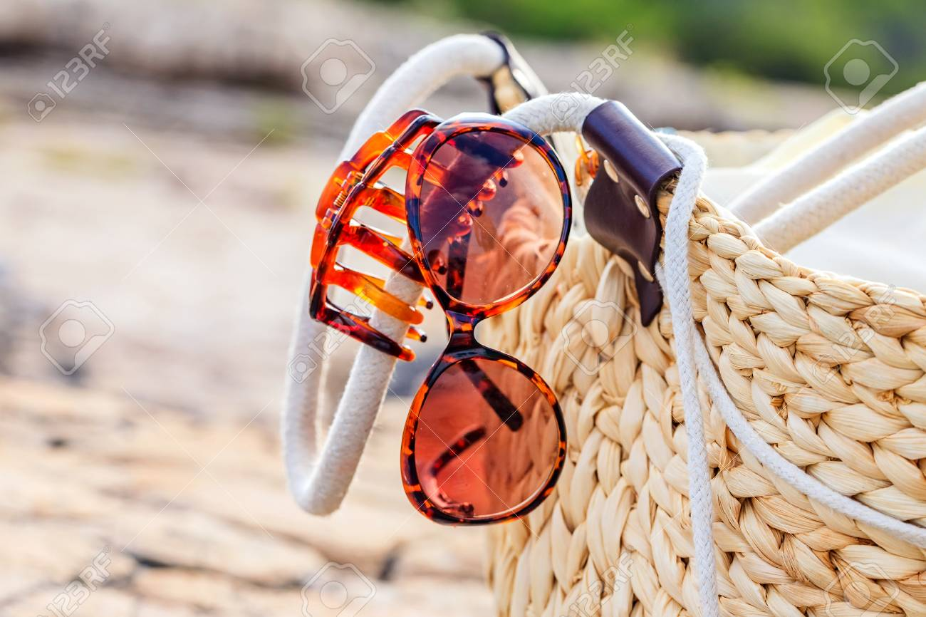 7f315fae56a Photo of beach bag and womanly accessories Stock Photo - 70888218