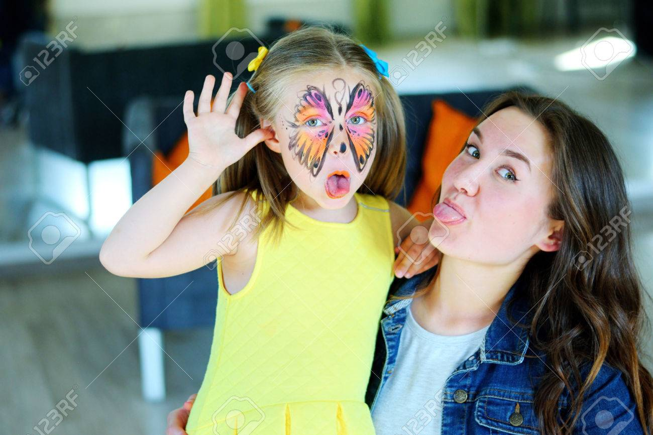 Pretty girl with face painting of a butterfly Stock Photo - 80700679