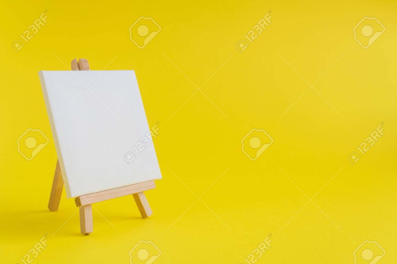 Easel For Artists And Blank Canvas Miniature On Pastel Yellow ...