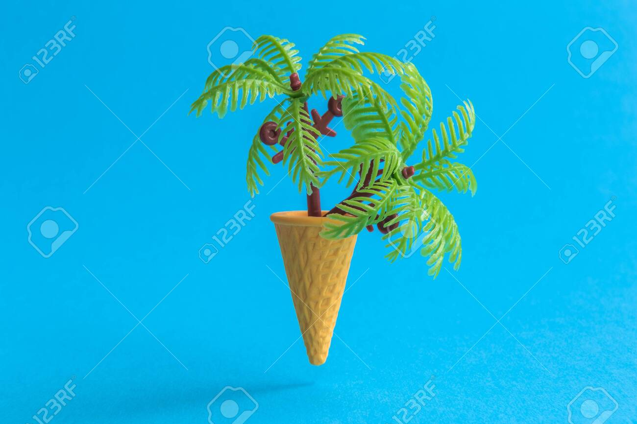 Ice cream cone with palm trees against pastel blue background minimal summer vacation tropical creative concept. - 127132127