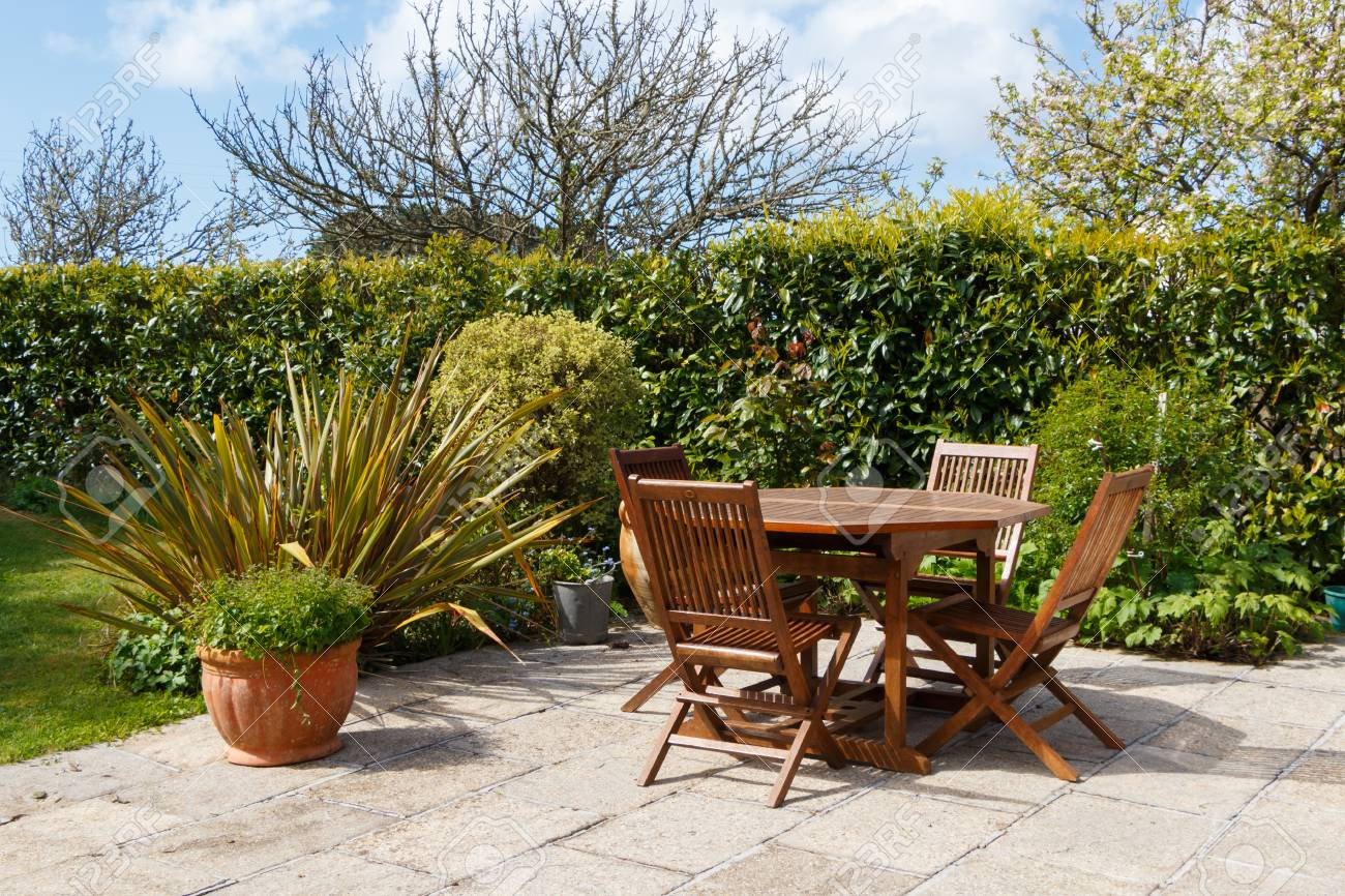 Terrace In Pavement And Wooden Garden Furniture In A Garden