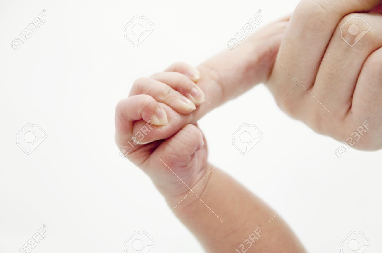 A Baby's hand holding her Mom's finger Stock Photo - 7910016