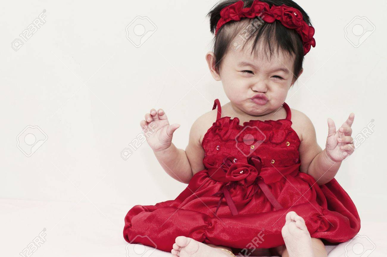 little baby girl with funny expression stock photo, picture and