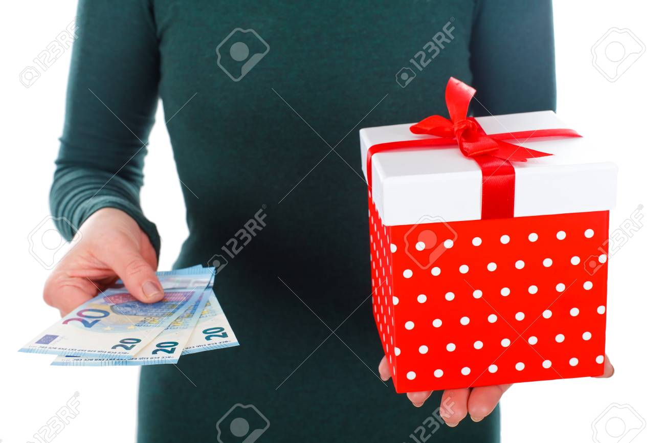 close up picture of a woman holding a christmas gift and money stock photo 66278499