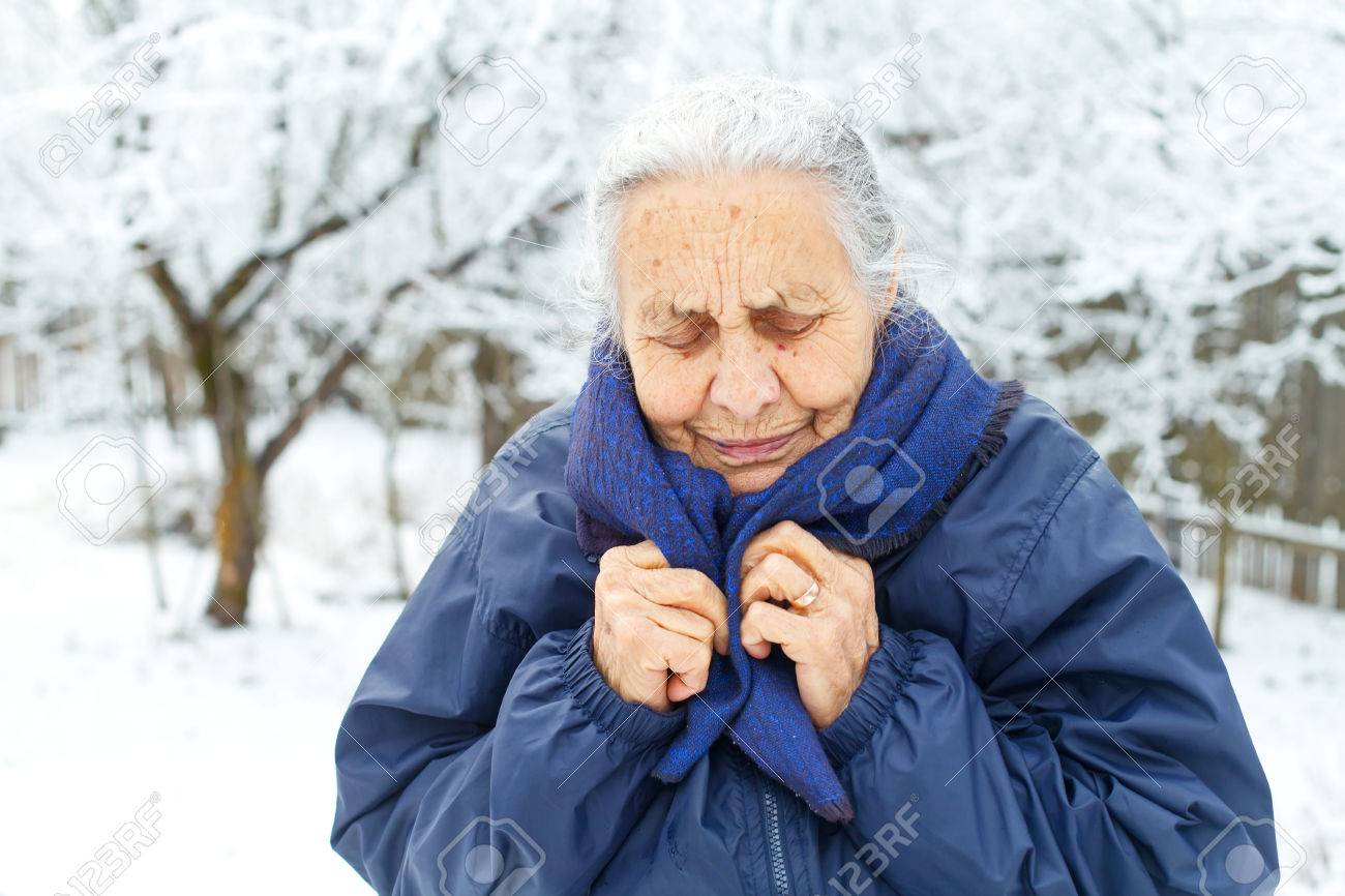 Picture of an old lady feeling cold on wintertime - 68175613