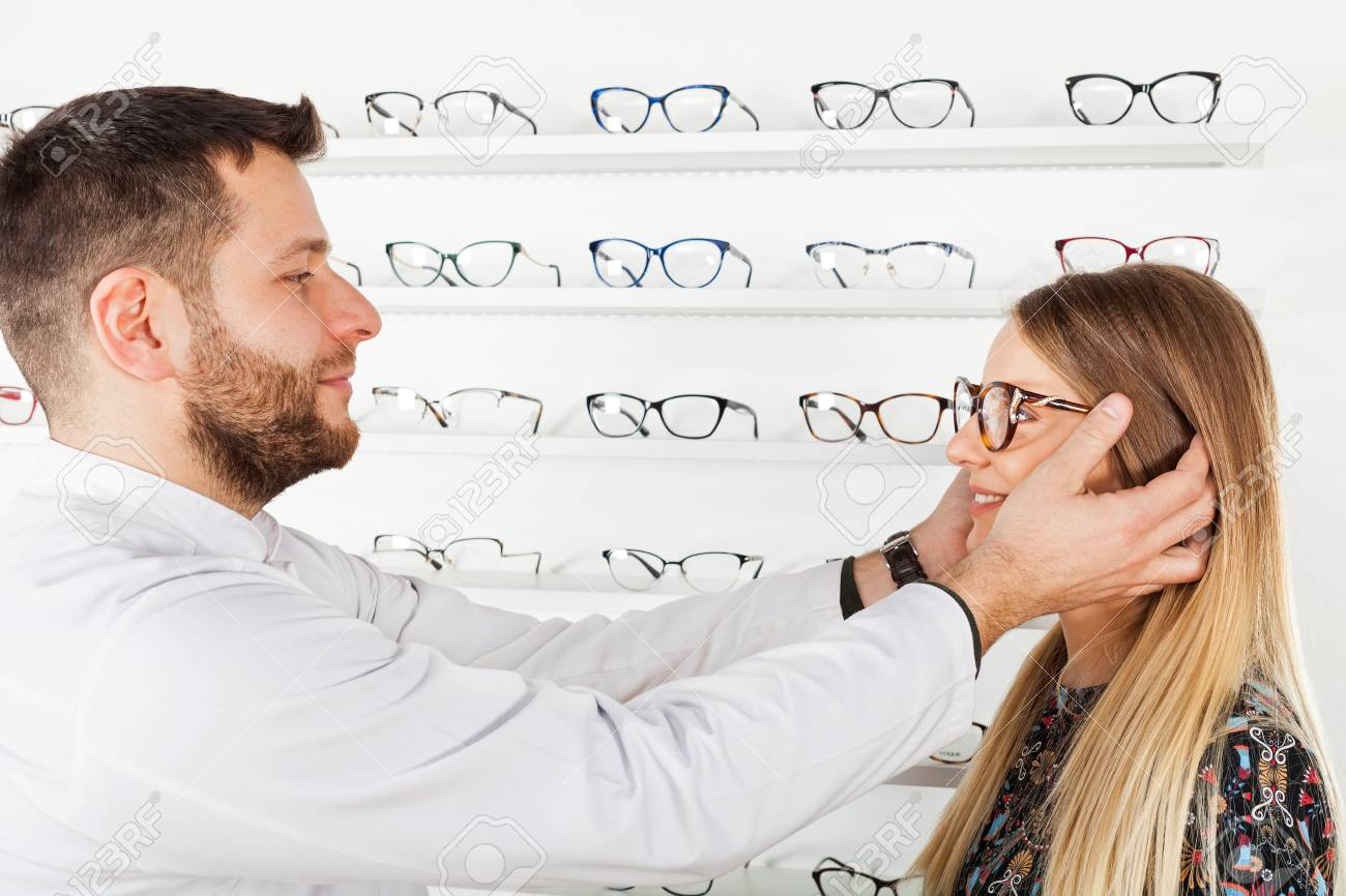 Friendly Male Ophthalmologist Choosing Eyeglass Frame For Beautiful ...