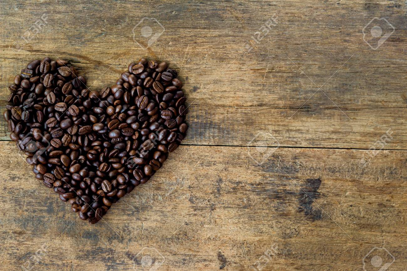 Heart Chape From Coffee Beans Lovely By Roasted On Rustic Wood