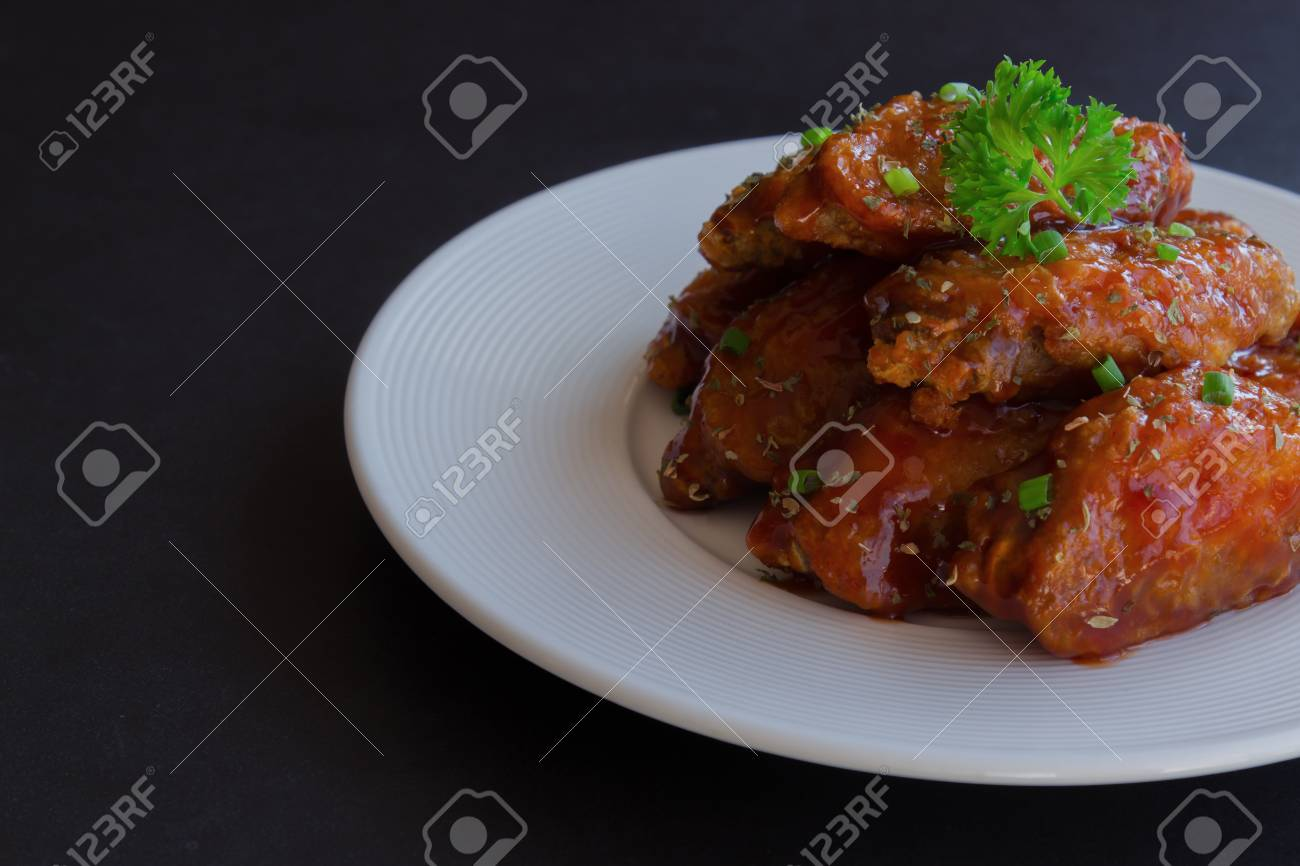 Barbecue Chicken Wings On White Plate Served With Barbecue Dipping