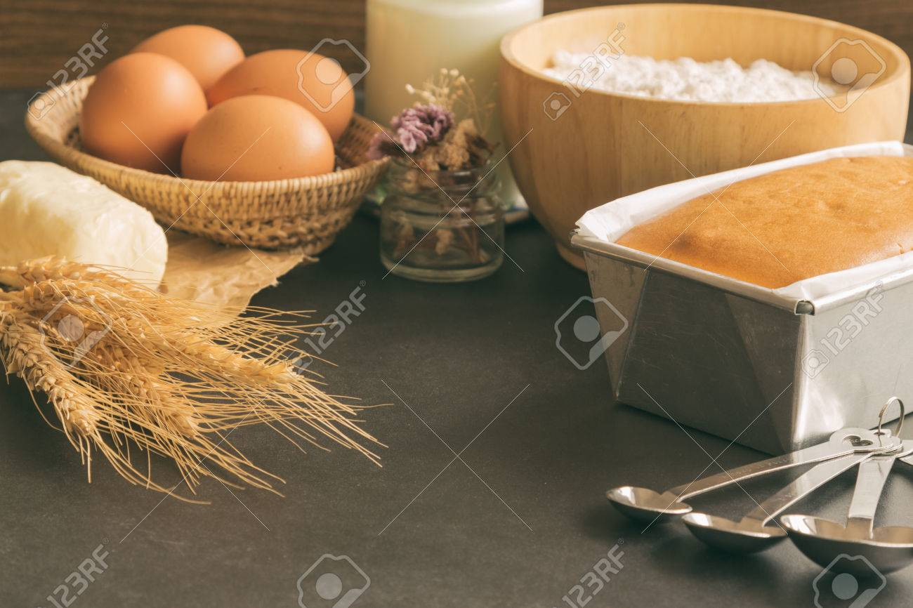 bakery background with butter cake and ingredients: eggs milk