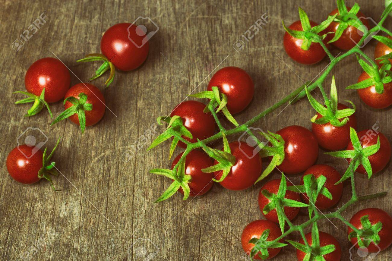 Fresh Cherry Tomato On Rustic Wood Table Top View For Background Or Wallpaper