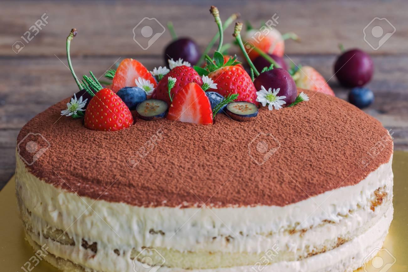 Round Tiramisu Cake On Wood Table Sprinkle With Cacao Powder Stock