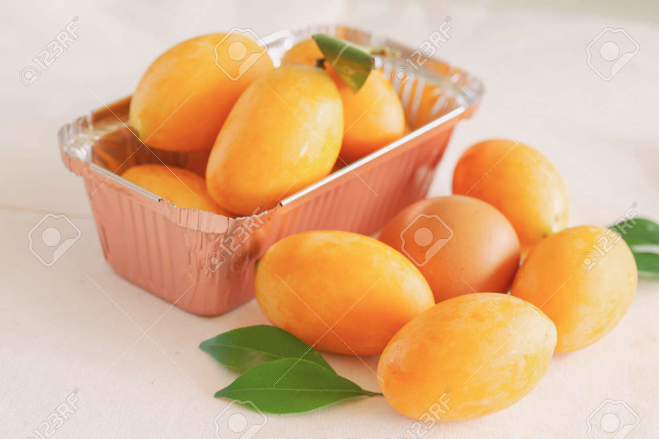 Big size fresh ripe organic sweet yellow marian plum or plum mango compare with egg on white background. Tropical exotic summer fruit call Mayongchid or Maprang in Thailand with sweet and sour taste. - 165172570