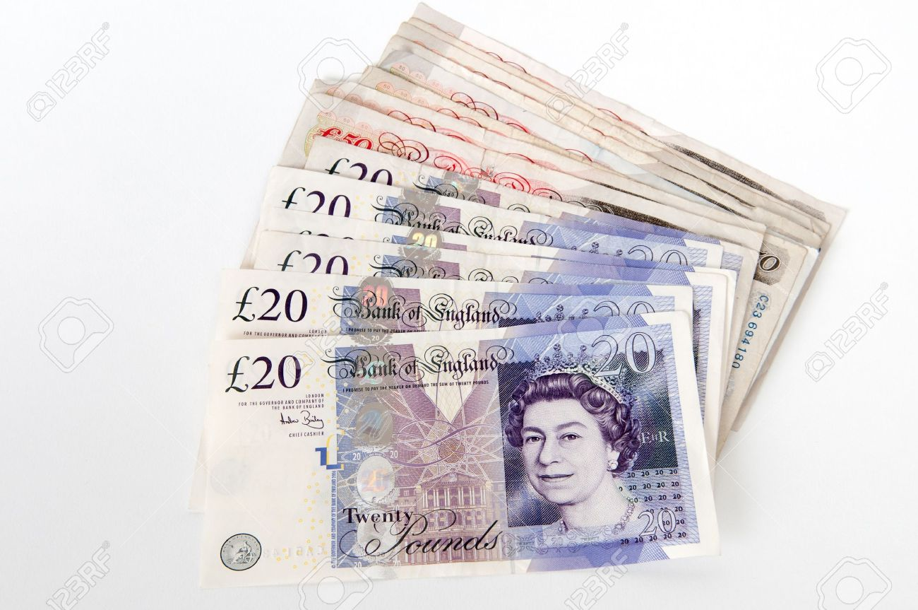 a stack of 20 and 50 great british pounds bank notes royalty free