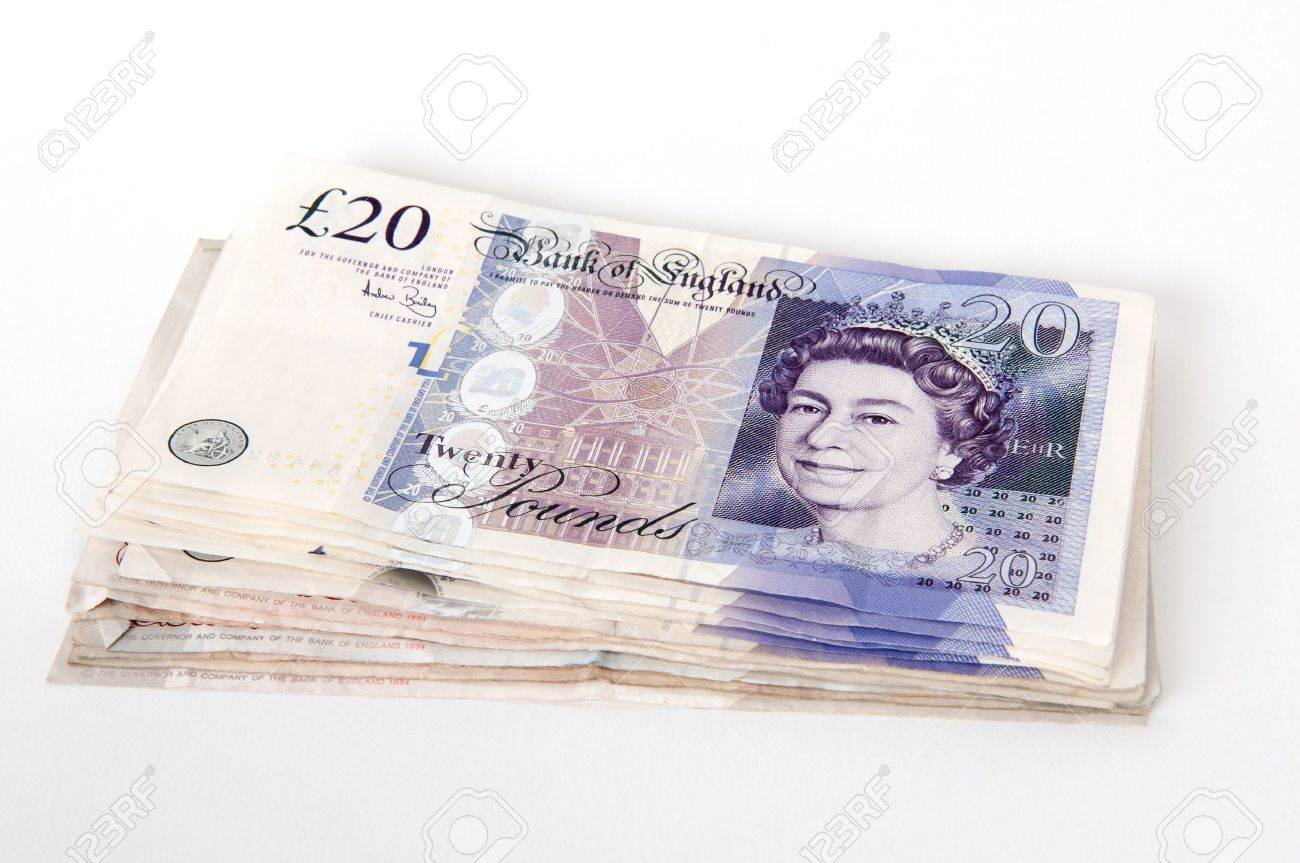 a stack of 20 great british pounds bank notes royalty free