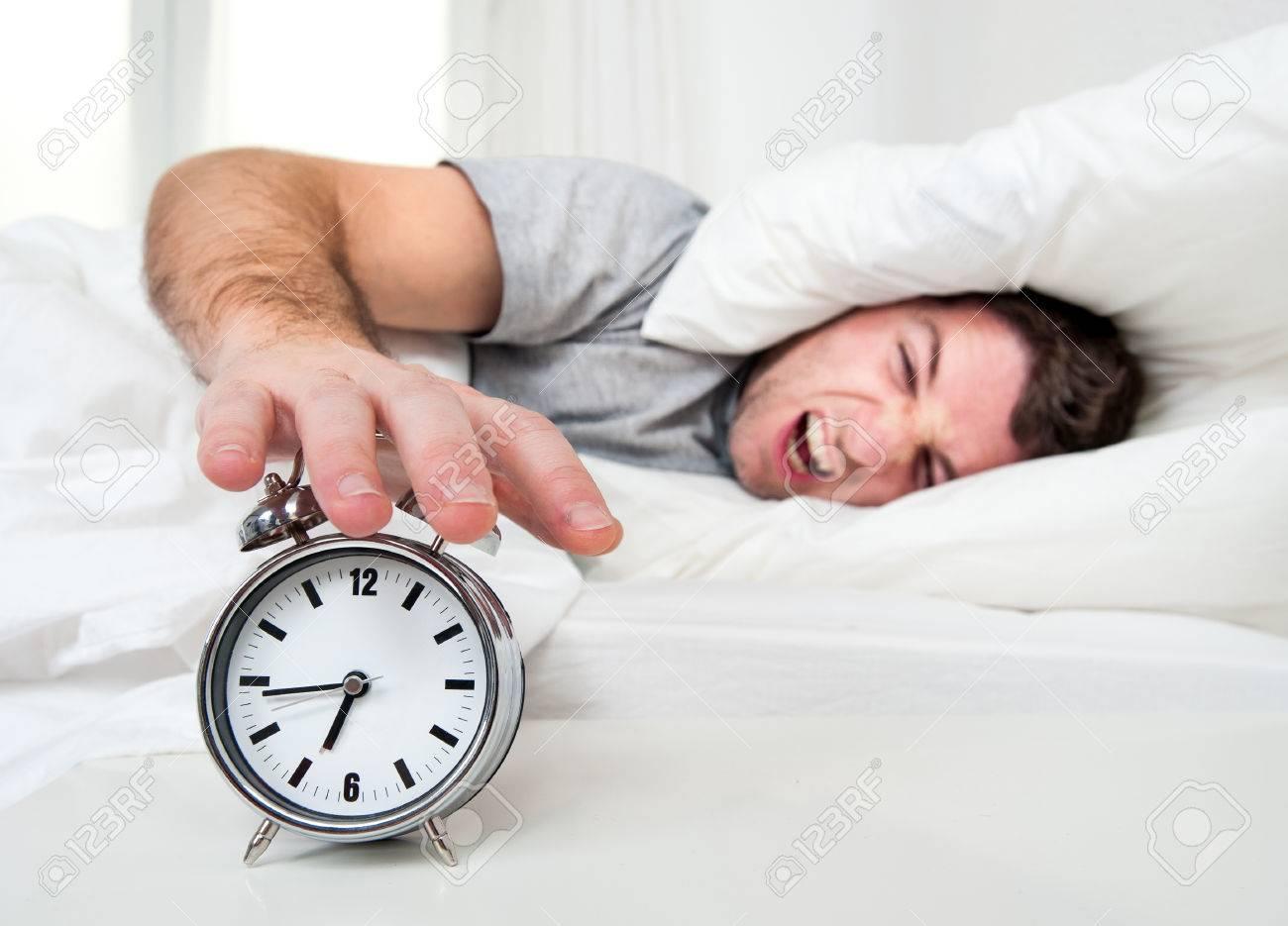 Sleeping Man Disturbed By Alarm Clock Early Morning Stock P O 25201211