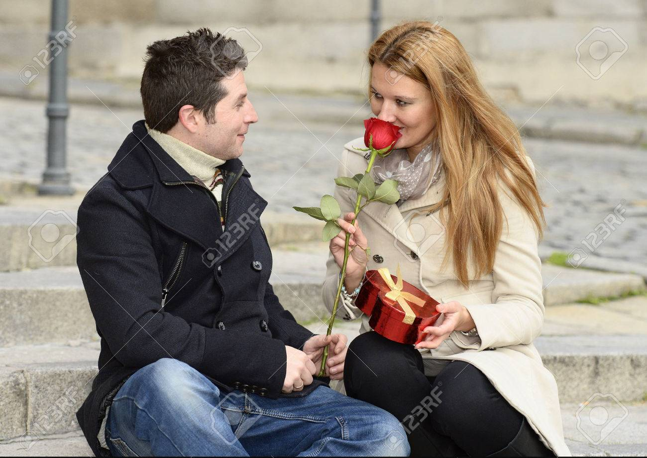 Romantic couple smelling a rose on Valentines day Stock Photo - 25300290