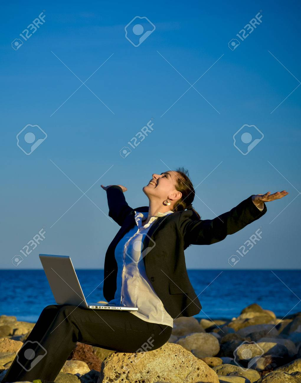 5a30e12cb8a1 attractive business woman working on a laptop sitting on some..