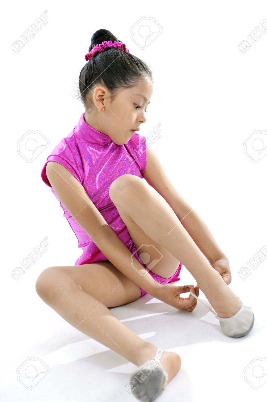 d78b15fd5 Latin Cute Young Little Girl Putting On Dancing And Ballet Shoes ...