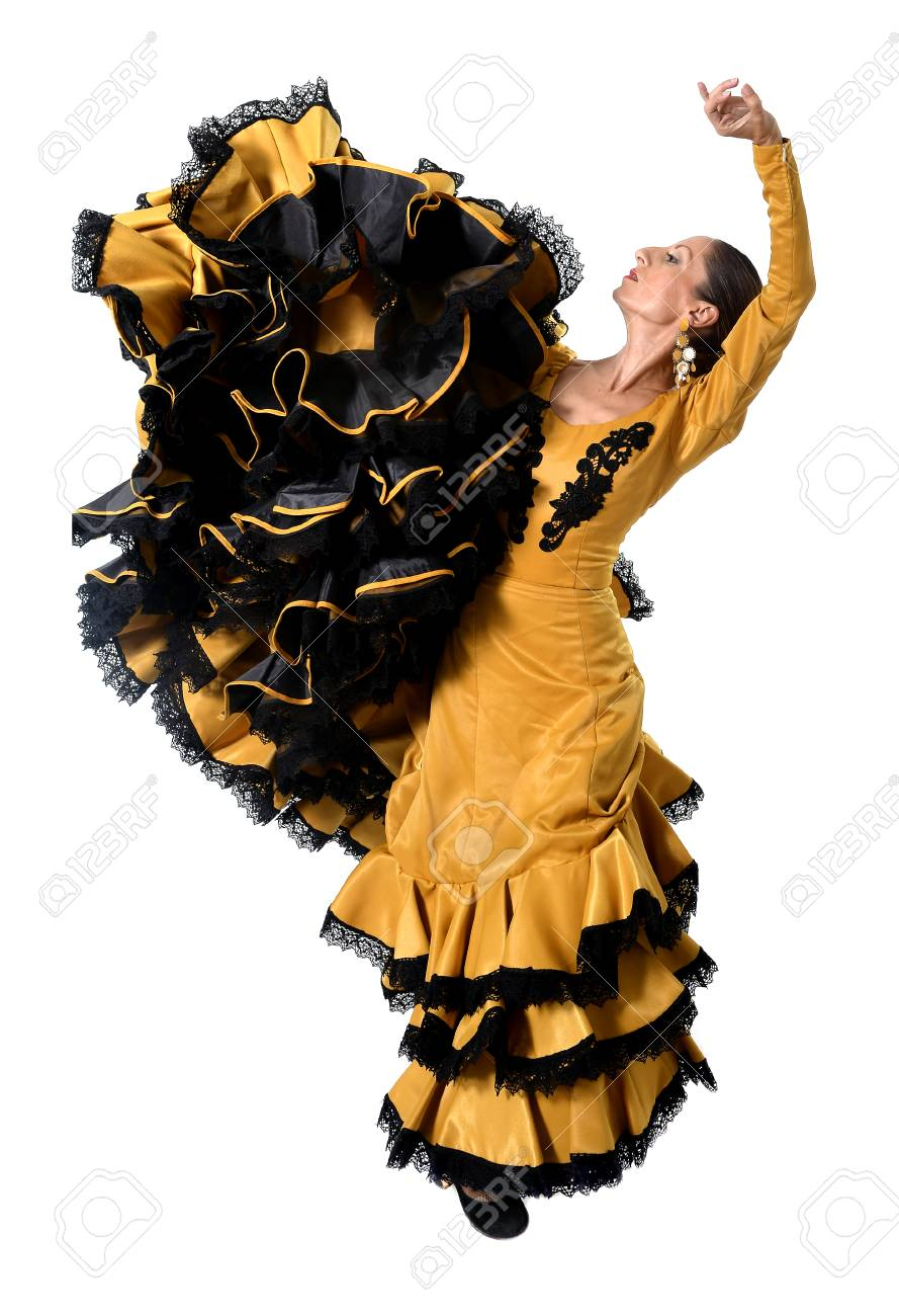 70c0cf611c78 Stock Photo - young spanish woman dancing Sevillanas wearing typical folk  gold and black tailed gown dress in flamenco traditional dance of Spain  concept ...