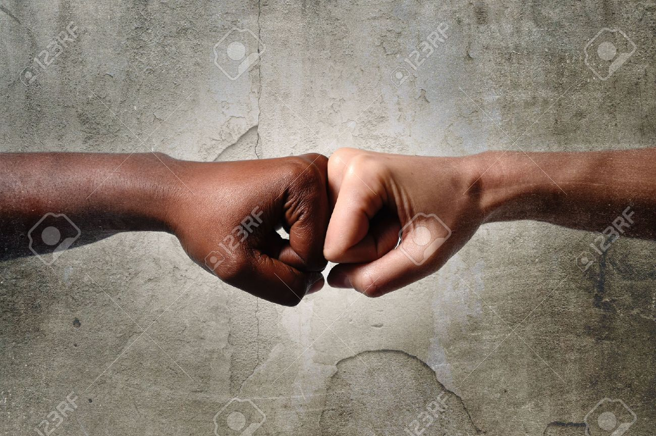 Black African American Race Female Hand Touching Knuckles With White
