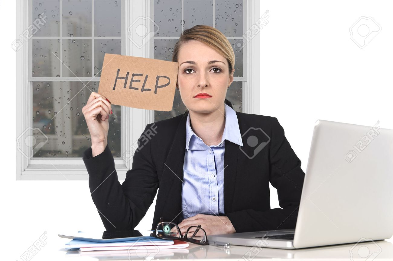 young attractive frustrated businessw holding help message stock photo young attractive frustrated businessw holding help message overworked at office computer exhausted desperate under pressure and stress