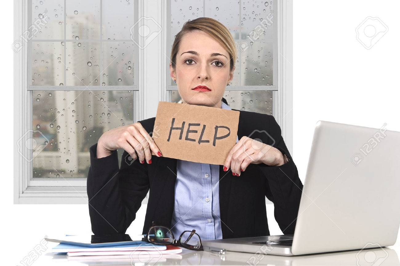 young attractive frustrated businesswoman holding help message overworked at office computer, exhausted, desperate under pressure and stress with rainy sad window view - 37362217