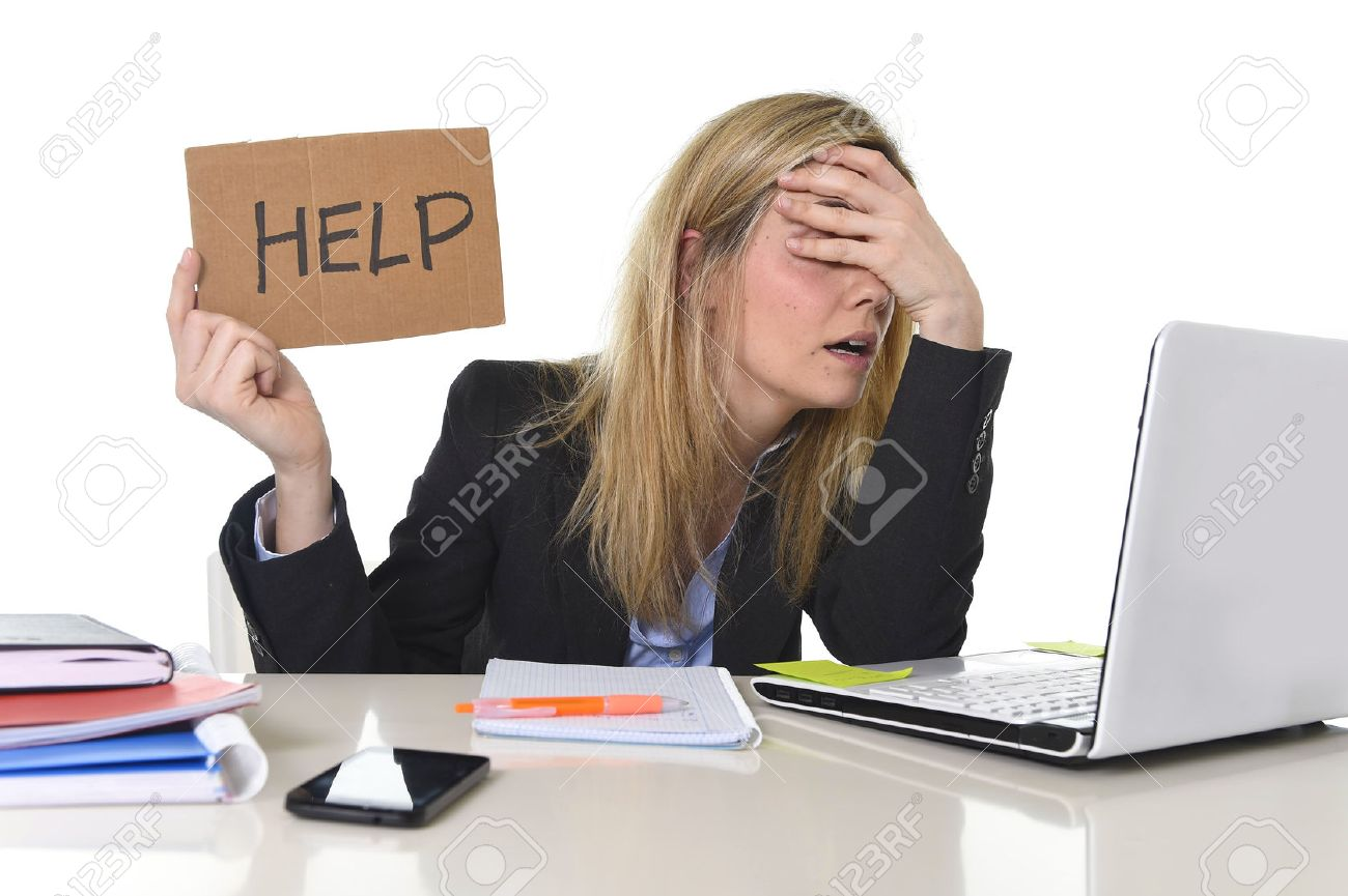 young beautiful business woman suffering stress working at office computer desk asking for help feeling tired and desperate looking overworked covering eyes overwhelmed and frustrated - 54016113