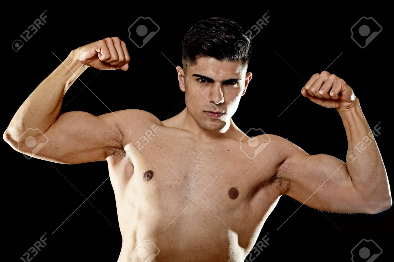 young handsome sport man posing with strong naked torso looking