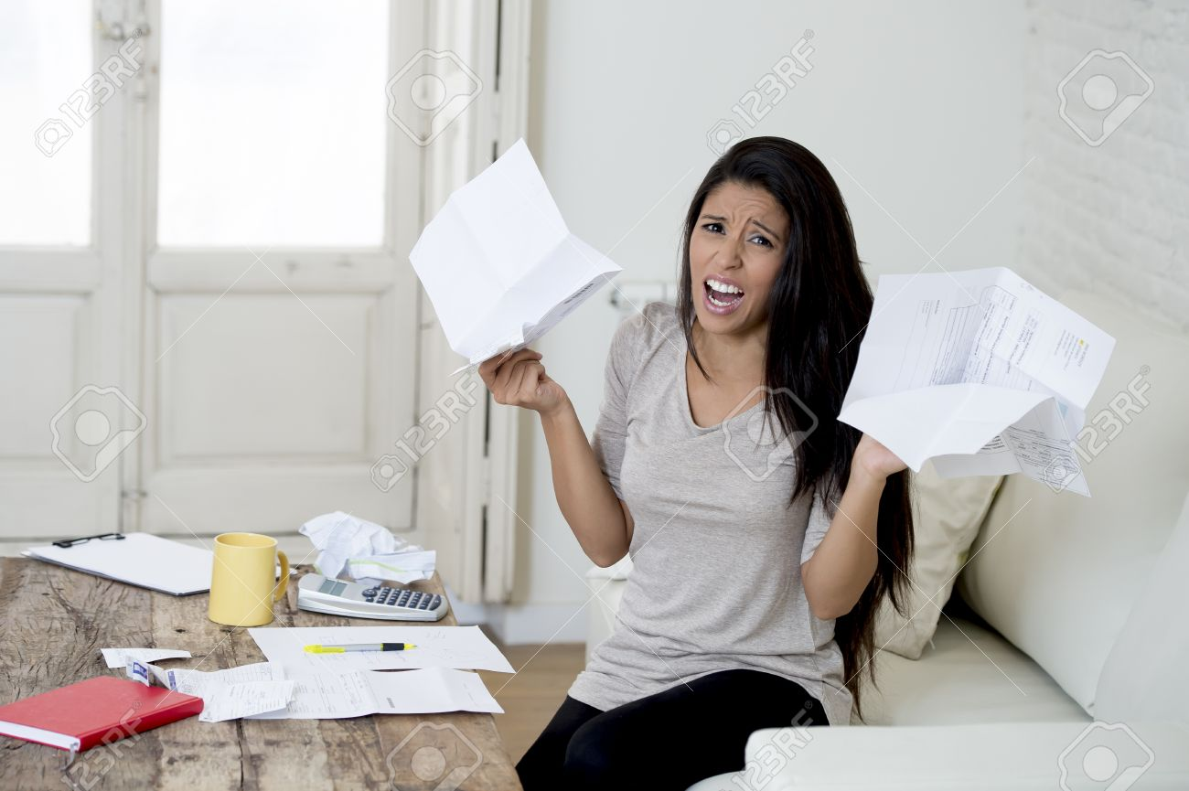 Elegant Crazy Desperate Latin Woman At Home Living Room Couch Calculating Monthly  Expenses Worried In Stress With