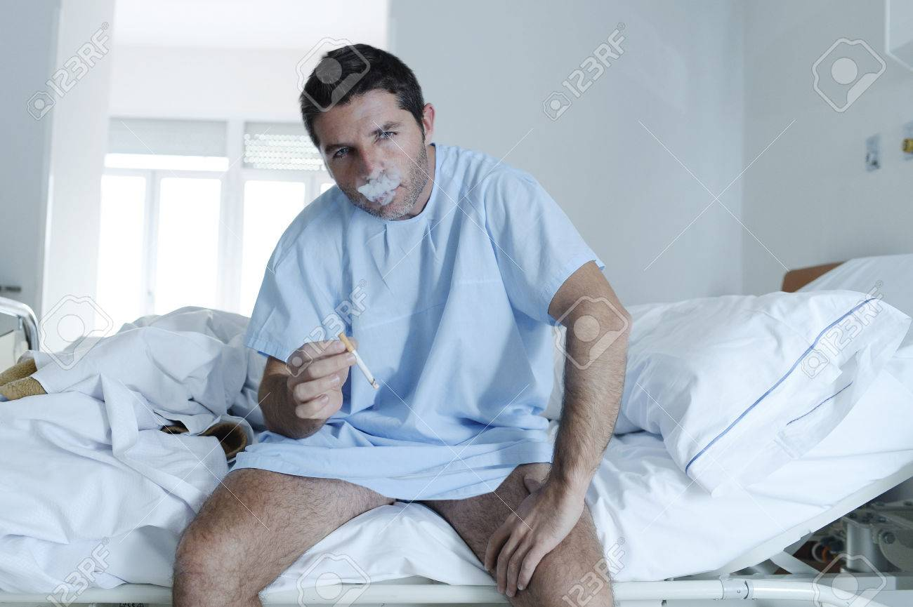 young attractive man looking sad and worried at hospital bed